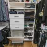 Master bed walk in with Organizers